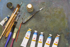 Oil paints and paint brushes. Oil paints and paint brushes on a palette Royalty Free Stock Photo