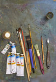 Oil paints and paint brushes. Oil paints and paint brushes on a palette Stock Photo
