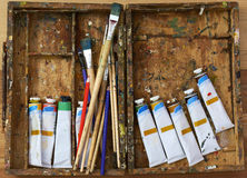 Oil paints and paint brushes Stock Image