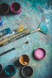 Oil paints palette and paint brushes, close up Stock Photos