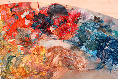 Oil paints on wooden palette Royalty Free Stock Images