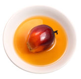 Oil palm fruit and cooking oil Royalty Free Stock Photos