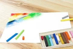 Oil pastel art picking for art drawing on paper book and set box of colorful crayons on wood table background with copy space for. Text stock images