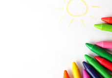 Oil pastel crayons lying on a paper with painted children's draw Stock Photo