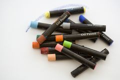Oil Pastels. Artists oil pastels on a white canvas background with copy space Stock Images