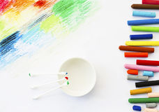 Oil pastels crayons colorful art drawing and cotton bud on white Stock Image