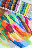 Oil pastels crayons on colorful background Stock Image