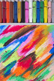 Oil pastels crayons on colorful background Royalty Free Stock Image