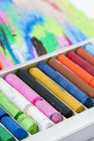 Oil pastels crayons on colorful background Royalty Free Stock Photo
