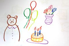 A birthday of a bear on the kid`s drawing Royalty Free Stock Image