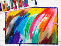 Oil pastels drawing and crayons. On wooden background Stock Photos