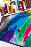 Oil pastels drawing and crayons. On wooden background Stock Image