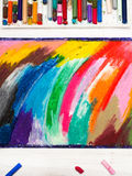 Oil pastels drawing and crayons. On wooden background Royalty Free Stock Photos