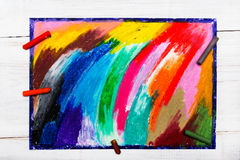 Oil pastels drawing and crayons. On wooden background Royalty Free Stock Photo