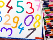 Drawing: math lesson with colorful numbers. Oil pastels drawing: math lesson with colorful numbers royalty free stock image