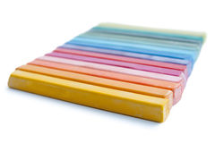 Oil pastels organized like a rainbow isolated on a white background Royalty Free Stock Photos
