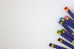 Oil Pastels. Rainbow colored oil pastels scattered on white background Royalty Free Stock Photo
