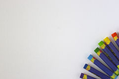 Oil Pastels. Rainbow colored oil pastels scattered on white background Stock Images
