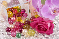 Oil pearls and flowers Royalty Free Stock Photography