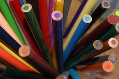 Oil pencils. Unsharpened close up view royalty free stock photo