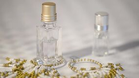 Oil perfume in a glass bottle.Aromatherapy. Sunlight,and sunbeams.