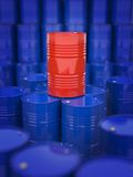 Oil and Petroleum. Red Oil Drum Standing on the Background of Blue Barrels Royalty Free Stock Images
