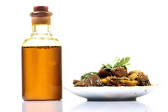 Oil and pickle. Mustard oil bottle with pickle plate isolated on white background Stock Images