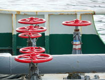 Oil Pipeline Control Valves. Pipes and control valves on an oil supply ship royalty free stock images