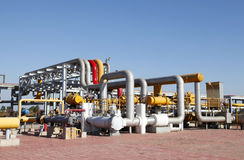 Oil pipeline. Oil field scene, oil pipelines and facilities royalty free stock photo