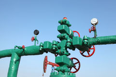 Oil pipeline. Piping and valves of oil field, close-up royalty free stock photos