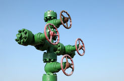 Oil pipeline. Piping and valves of oil field, close-up royalty free stock photo