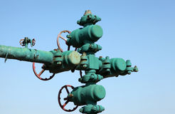 Oil pipeline. Piping and valves of oil field, close-up royalty free stock images