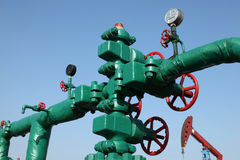 Oil pipeline. Piping and valves of oil field, close-up royalty free stock photography