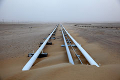 Oil pipeline in Qatar royalty free stock image