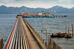 Oil pipeline and tanker Stock Images