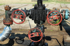 Oil Pipeline and Valves. The extraction of petroleum at oil well Royalty Free Stock Photography