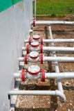 Oil pipelines from the pumping station belonging to the ground Royalty Free Stock Photography