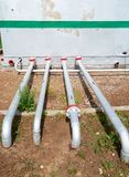 Oil pipelines from the pumping station belonging to the ground Royalty Free Stock Photo