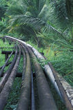 Oil pipelines in rain forest, Trinidad. Oil pipes in the rain forest of southern Trinidad, West Indies. Trinidad has sizeable oil and gas reserves, and petroleum Stock Images