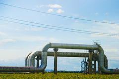 Oil pipes. A picture of large oil pipes, laid across and open field Stock Photo