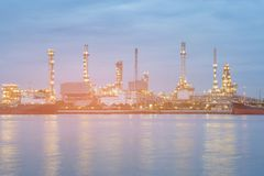 Oil plant, refinery factory. River front at twilight royalty free stock photos
