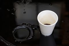 Oil and plastic cup stock photo