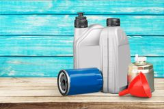 Plastic containers for motor oil on wooden. Oil plastic motor containers motor oil spare parts auto parts Stock Images