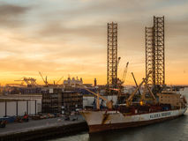 Oil platform Atlantic and cargo ship Chilean Reefer in the port of IJmuiden Royalty Free Stock Photos