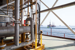 Oil platform constructions and pipes Stock Images