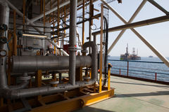 Oil platform constructions and pipes Royalty Free Stock Images
