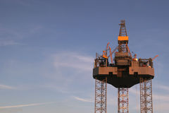 Oil platform with copy space. An oilrig against a blue sky, some clouds Royalty Free Stock Image