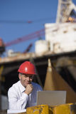 An oil platform inspector with his laptop Stock Images