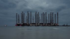 Oil platform in the night sea. In evening royalty free stock photo