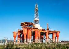 Oil platform in renovation in Belfast. BELFAST, NORTHERN IRELAND, UK - SEPTEMBER 25, 2016: Oil drilling platform in renovation in Harland & Wolff shipyard in royalty free stock photo